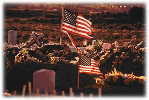US flags and tombstones for national moment of remembrance day