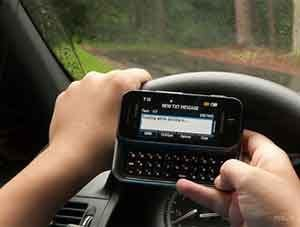 teen texting while driving in rain