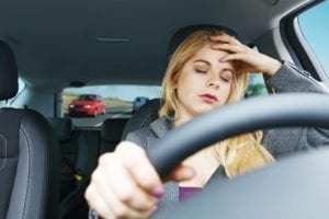 Blond female driving drowsy in West Virginia