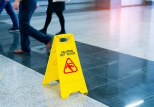 wet floor sign slip fall lawyers make a case against