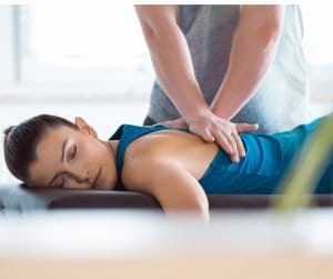 Young woman injured in accident getting massage